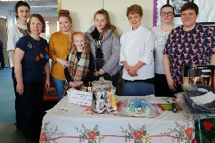 Mary Anderson's daughter Clare and granddaughters Heather and Hayley with school kitchen staff at this year's fair.