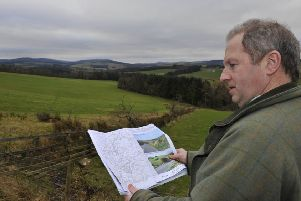 Philip Kerr looking towards the site now safe from turbines.
