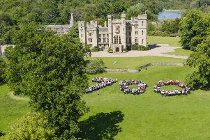 Herding them in...Berwickshire High and Duns Primary School pupils form 700 in front of Duns Castle. (Pic: Sky Vantage Productions)