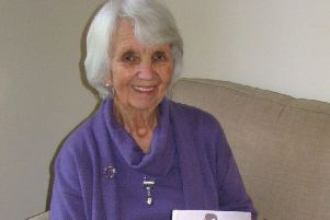 Isabella Reid Murray with a copy of her book From the Corners of My Mind.