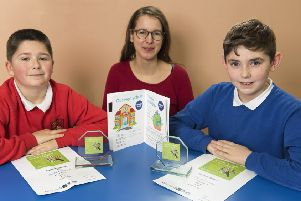 Johnshaven Primary School pupils Nathan Watson and Aiden Wardrop pictured with  the school's language teacher Frida Mittmann who teaches French and Spanish.