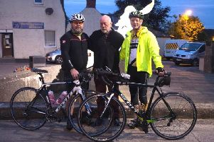 Dave Ramsay (centre), with cyclists Ronan Littlejohn and Gary Thomson.