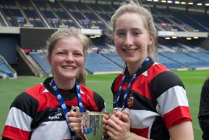 Lenzie's Kirsty Martin (left) and Niamh Proctor after helping Stirling County win the under-18 Scottish cup