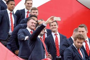 Stuart Hogg poses for some snaps with the rest of the Lions squad on the steps of the plane
