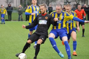 Steven Seatomn holds off the Hurlford defenders during Saturday's cup tie (pic by HT Photography/@dibsy_)