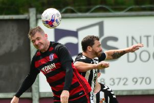 Rob Roy's Willie Sawyers in an aerial duel (pic by Stephen Kerr)