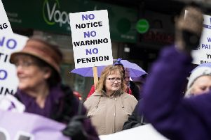 """John Devlin 08/03/2018. GLASGOW. 'Glasgow WASPI group mark International Women's Day today by campaigning on the streets of Glasgow city centre.''A series of events will take place throughout the day to raise awareness of state pension inequality.''The day includes a presence at the opening of the Mary Barbour Statue in Govan, where many of their forebears campaigned for the introduction of the Rent Act.''This will be followed by a procession of 100 WASPI women through Glasgow city centre, leaving Shuttle Street at 1pm, marching along Argyle Street and back to George Square.'There the group hope to start the WASPI tree, where each woman affected ties on a purple ribbon and for those who have passed on the group will have purple and white ones.''This will be a visual representation of how much money the Government has retained due to the changes and the ��magic money tree�"""".''Later at 6pm the Glasgow group will be joined outside the Scottish Hydro - which is being lit up Purple for WASPI - with members from"""