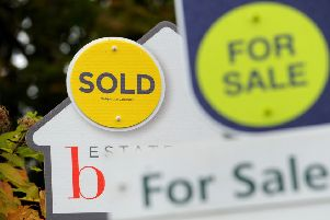File photo dated 14/10/14 of Sold and For Sale signs as house prices across the UK increased at their lowest annual rate in around seven years in July, according to official figures.