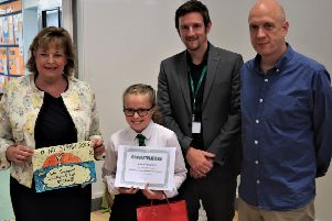 Zara is pictured with Fiona Hyslop, Springfield head teacher Mark Wells and John Richardson.