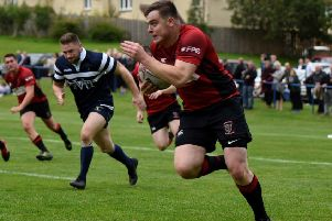 Ross Plenderleith on his way to scoring Linlithgow's try at Livingston.