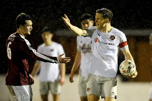 Rose's Ross Barbour with Hearts skipper Christophe Berra who made his return after injury at Prestonfield (pic by Michael Gillen).
