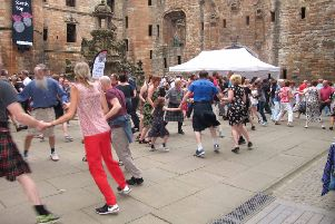 Dancers of all ages and nationalities pack the courtyard at Linlithgow Palace at this year's Scotch Hop