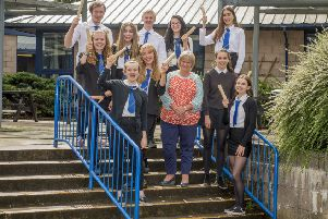 Pupils from Linlithgow Academy celebrate their exam success with Headteacher Karen Jarvis. Photo by Ian R Fleming.