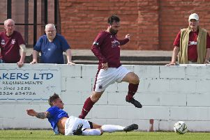 Linlithgow Rose v Whitehill Welfare, Prestonfield, Linlithgow.  Thomas Coyne of Rose and  Robbie Dowie of Welfare   Neil Hanna Photography