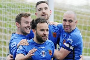Bo'ness players celebrate as they move four clear at the top