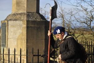 A historical re-enactor carrying a Lochaber axe ponders the slaughter which ensued when British and Jacobite armies collided on Falkirk Muir in 1746.