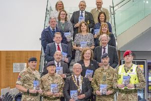 Council staff, service personnel and veterans at the launch.