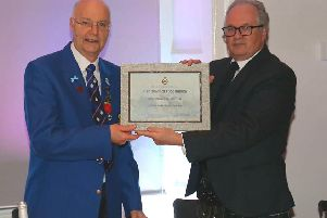 Brian McArtney, President of the Royal Caledonian Curling Club presenting a Certificate of Recognition of the Club's 200 years to George McNeill, President of Linlithgow Curling Club.
