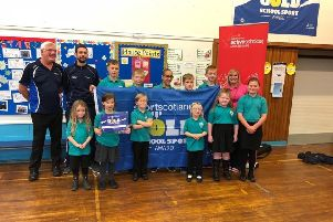 Left to right -  Ian Mc Gregor, partnership manager at sportscotland, Robbie Kupris, active schools  o-ordinator, the sports and health committee (P1-7), and head teacher Jenny Glennie