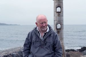 Jim Malcolm beside one of his sculptures