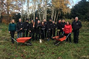 Danielle Rowley MP (in red jacket), tree planting with Newbattle Abbey students.