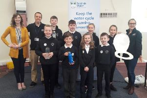Scottish Water's Midlothian campaign at St Luke's RC Primary School in Mayfield. Alongside the pupils are Scottish Water staff Scott Fraser and Louise Grahame and the school's deputy headteacher Kirsty Hadden (in yellow cardigan.