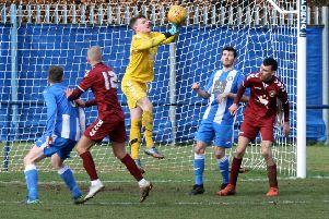 Oakley goalkeeper Robertson punches clear at a corner kick (picture: Jim Dick)