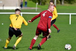 Arniston Rangers' Stephen Wilson in action