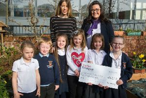 Linzi Holdsworth (Taylor Wimpey East Scotland sales executive at Greenlaw Mill) with children from Mauricewood Primary in Penicuik. Picture Copyright Chris Watt.