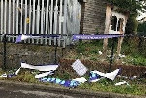 The damage to the noticeboard and banners at Loanhead Community Centre