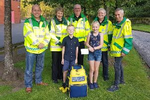 Sophie and Glen with Penicuik Community First Responders from left to right : Bill Lawson, Yvonne Mitchell, Alan Dickson,  Gilbert Kirkwood and Douglas Wilson.