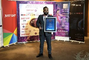 Habibur Khan from Dalkeith restaurant Itihaas with the award for Best Asian Restaraunt in Midlothian.