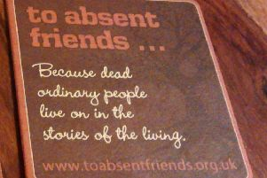 A beer mat promoting 'to absent friends' week.