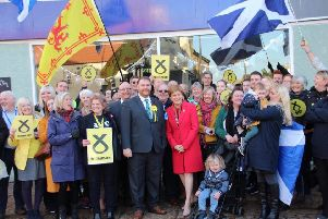 Owen Thompson and Nicola Sturgeon with supporters in Dalkeith.