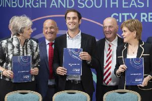The signing of the deal in August 2018, with Midlothian Council leader Derek Milligan second from right.