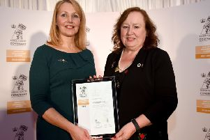 Pictured receiving the award are Midlothian Council Communities Officer Gillian Cousin (left) and Natalie Cutler from Lothian Armed Forces and Veterans Project.