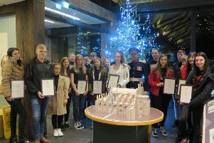 Pictured are young people who have achieved their silver and bronze Duke of Edinburgh awards at a presentation ceremony held on Wednesday 4 December at Rosslyn Chapel. Also pictured is Sir Robert Clerk, the Lord Lieutenant of Midlothian who presented the awards.