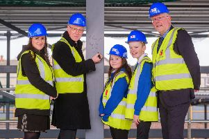 John Swinney is pictured, from left to right with head teacher Stephanie Campbell, P7 pupils Hazel and Max and Midlothian Council's Cabinet Member for Education, Councillor Jim Muirhead