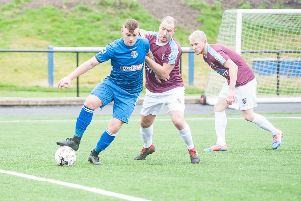 Action from the Bo'ness United v Whitehill Welfare, East of Scotland Premier League match at Newtown Park, Bo'ness''In pic............ Bo'ness forward, Keiron Anderson tussles with a Whitehill defender'''(c) Wullie Marr Photography