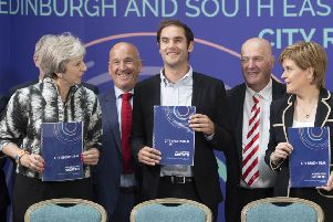 Prime Minister Theresa May, City of Edinburgh Council leader Adam McVey, Midlothian Council leader Derek Milligan and First Minister Nicola Sturgeon after signing the Edinburgh and South East Scotland City Region Deal at the University of Edinburgh in August 2018.