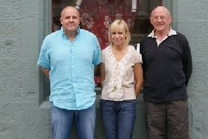 Andrew Knowles and son shop on the High Street, Bonnyrigg is set to close its doors. Pictured: Robert (R) with his son Bill and wife Ruth