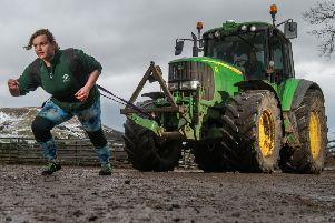 Strongwoman Kim Best, a lab scientist for Scotland's Rural College (SRUC) at its Veterinary'and Analytical Laboratory at Moredun's Pentlands Science Park,  borrowed one of her employer's six-tonne tractors while training for her next event. Photo by Phil Wilkinson.