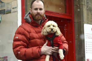 Pic Lisa Ferguson 24/02/2020 ''Alan with his dog Maggie, outside the post office in Roslin.