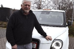 Pic Lisa Ferguson 24/02/2020. '''Electric taxi owner Gerry McCabe is angry at the lack of infrastructure for electric vehicles in Midlothian.