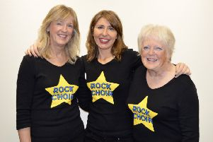 Rock Choir lend their voices    to help X-Factor winner Sam