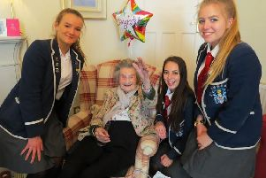 Flo Smith celebrated her 108th birthday - she is here with pupils from her former school.