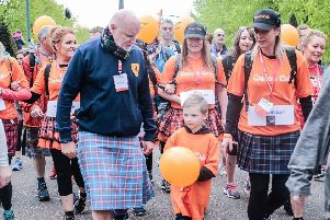 Sir Tom Hunter and lead walker six-year-old Nathan Mowat with mum Gill