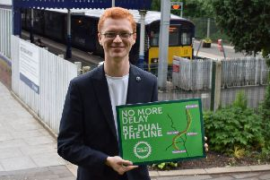 Greens MSP Ross Greer launches public petition to dual Milngavie rail line.