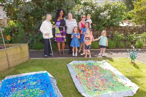 Milngavie Manor residents Eleanor Cheyne and Eileen Brooks with artist Josephine MacLeod (artist), parent Carly Inskip  and youngsters Lucy Eynon, Maisie Eynon, Finlay Eynon, Remi Sharp and Callum Gow