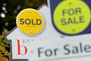File photo dated 14/10/14 of Sold and For Sale signs. House prices in Britain have increased by ??11 per day on average since the start of the year, analysis has found.